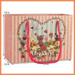 Low price fashion flower pattern paper bag with handles