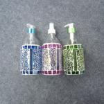 colorful lotion bottle with glass mosaic deco