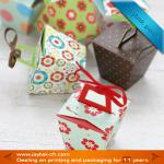 Folding cupcake boxes with ribbon handle